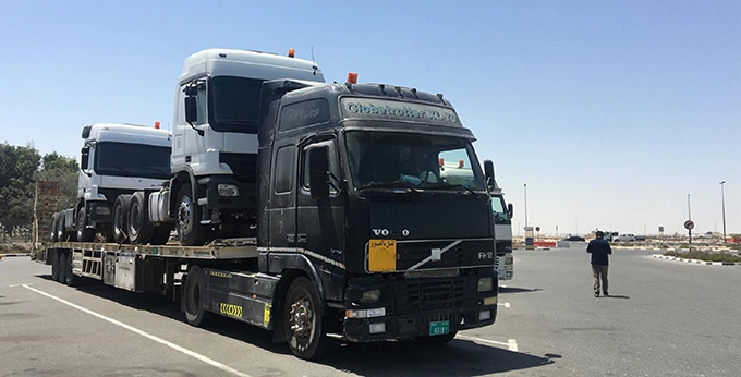A picture containing sky, truck, outdoor, road  Description automatically generated